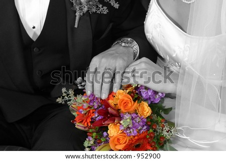 bridal couple in Black & White showing rings on bouquet in color - stock photo