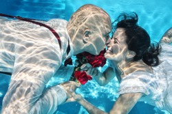 bridal couple kissing under water