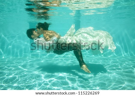 bridal couple underwater - stock photo