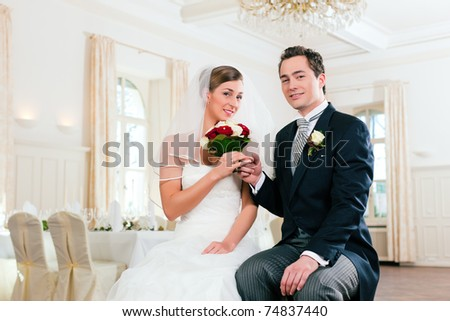 Bridal couple waiting for ceremony in a decorated hall