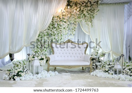 Bridal dais, wedding stage decoration built for the bride and groom on their wedding day. The couple will sit on the dais or pelamin