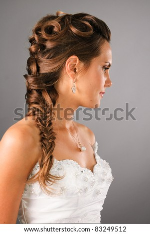 bridal hairdo with a plate on studio neutral background