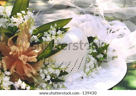 Bridal hat with flowers on picnic table