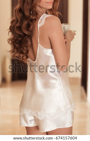 Bridal morning before wedding day in lace silk lingerie set