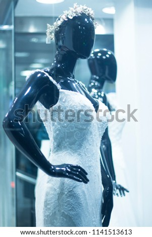 80841a116bd2 Bridal shop dummy bride mannequin in department store with white wedding  dress. #1141513613