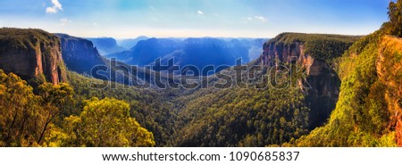 Bridal vale waterfall from Govett leap lookout towards Pulpit rock and surrounding sandstone mountain ranges in Blue Mountains on a sunny morning. #1090685837