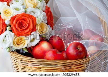 Bridal Veil, apples in a basket and bridal bouquet