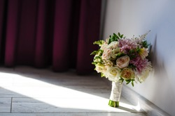 Bridal Wedding Bouquet on a grey wooden floor