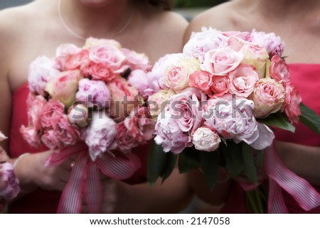 Bridal wedding bouquets of flowers, with a blurred effect on the backgrounf flowers, and focus on the flowers on the right