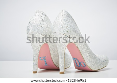 Bridal wedding shoes with I do message on sole isolated on white background Marriage concept