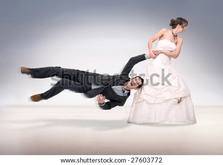 bride abusing groom - stock photo