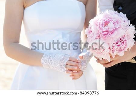Bride adjusting her wedding or engagement ring