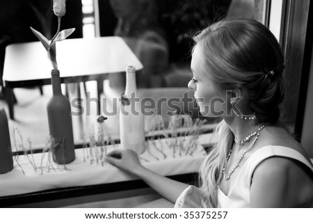 bride against window in cafe. Shallow DOF