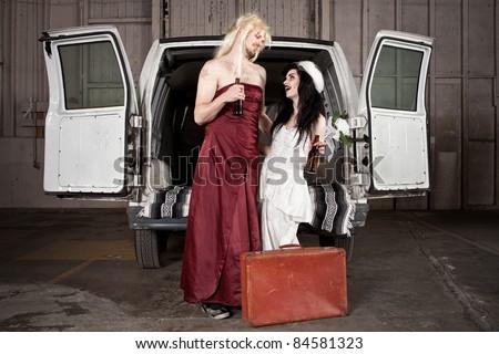 Bride and cross dressing Groom at Hillbilly Wedding