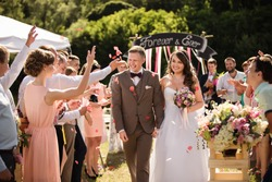 Bride and groom after wedding ceremony. Guests showered the newlyweds with rose petals