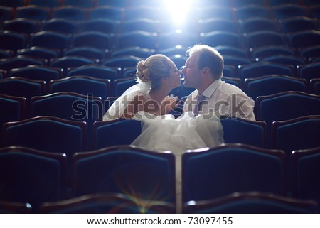 bride and groom at the theatre - stock photo
