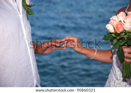 stock photo Bride and groom change rings on their wedding ceremony