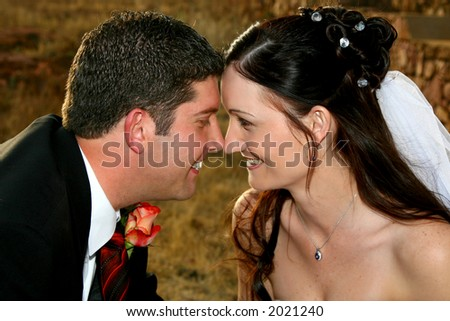 Bride and groom close together smiling