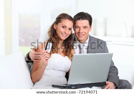 Bride and groom doing shopping on internet at home
