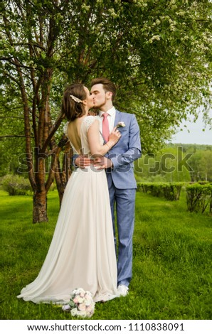 Bride and groom embraced and kissed on nature background. #1110838091