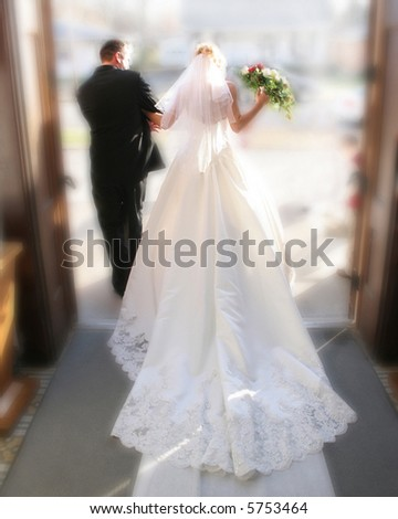 Bride and groom exiting church after being wed.