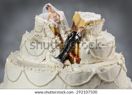 Bride and groom figurines collapsed at ruined wedding cake \ Spouses always seem to struggle to keep their relationship alive
