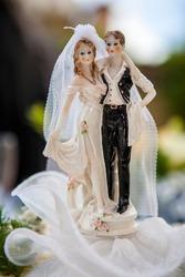 Bride and Groom figurines on wedding cake