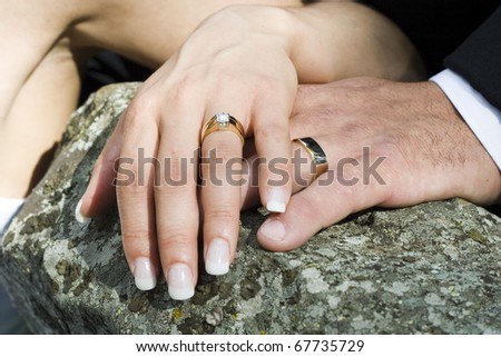 bride and groom hand detail shot - stock photo