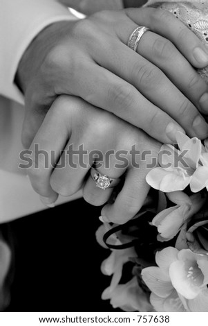 Bride and Groom holding hands (Black and White)