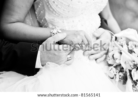 Bride and groom holding hands, black and white image