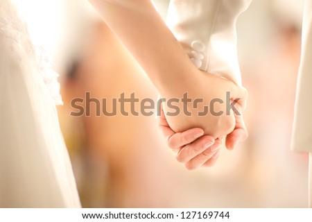 Bride and groom  holding hands in wedding celemony