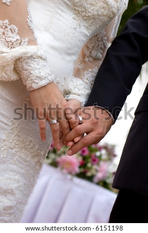 stock photo Bride and groom holding hands showing the wedding rings