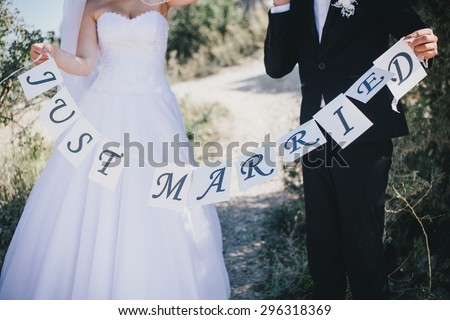 Bride and groom holding \