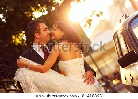 Bride and groom hugging in the city #181418855