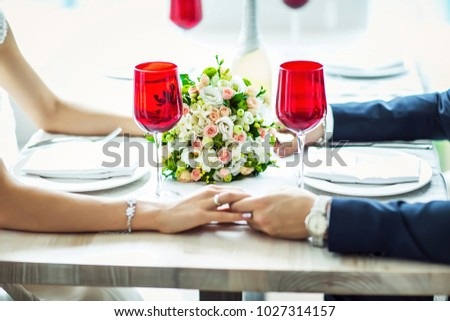 bride and groom in a suit sitting at served table, served table for the bride and groom, wedding decor and serving, wedding flower bouquet. #1027314157