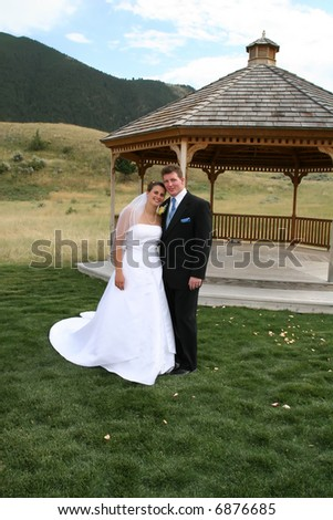 Bride and groom in front of a gazebo