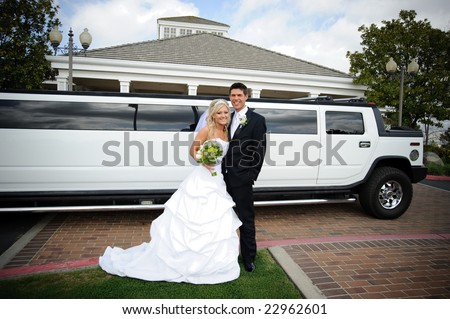 Bride and groom in front of the limo