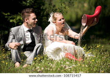 bride and groom in the nature trash the dress