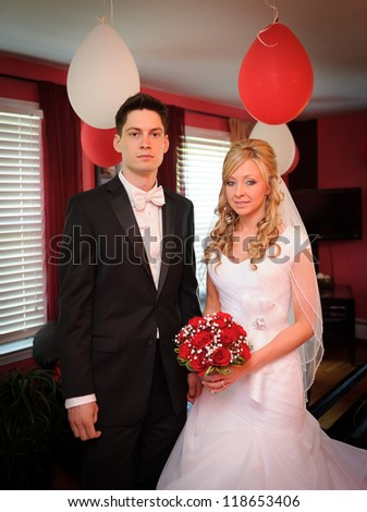 Bride and groom inside of the house