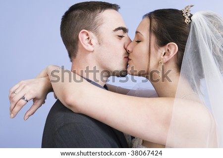 Bride and Groom kissing after the wedding ceremony.