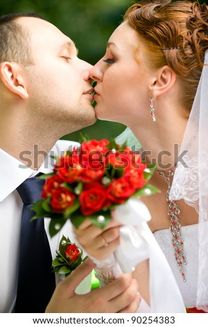Bride and groom kissing on the nature
