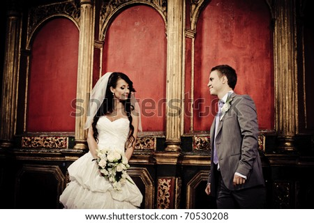 bride and groom looking at each other in a church