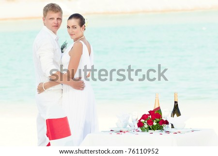 stock photo Bride and groom near the wedding table