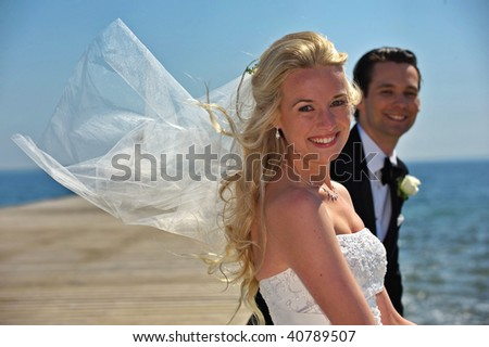 Bride and groom on a dock