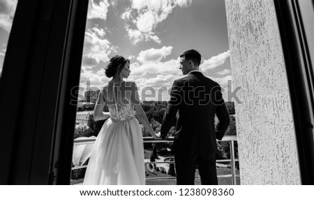 bride and groom on the balcony #1238098360