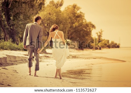 bride and groom on the beach #113572627