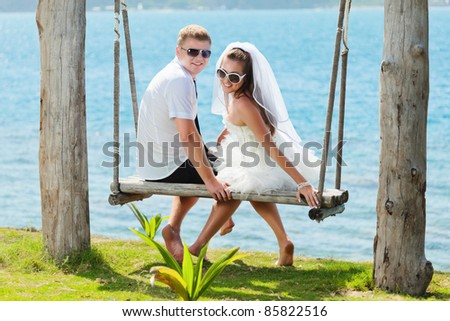Bride and groom on the tropical beach