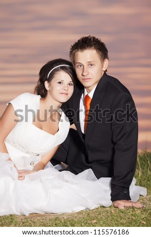 bride and groom portrait at sunset on a beautiful beach