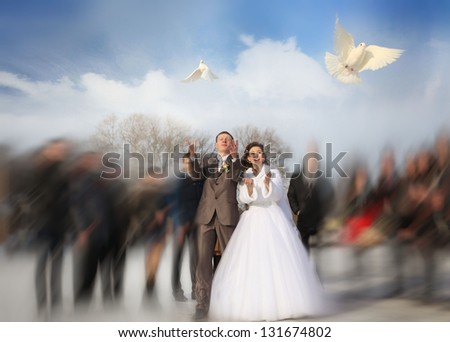 bride and groom release doves