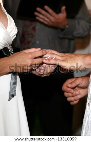Bride and Groom's hands being blessed at the wedding